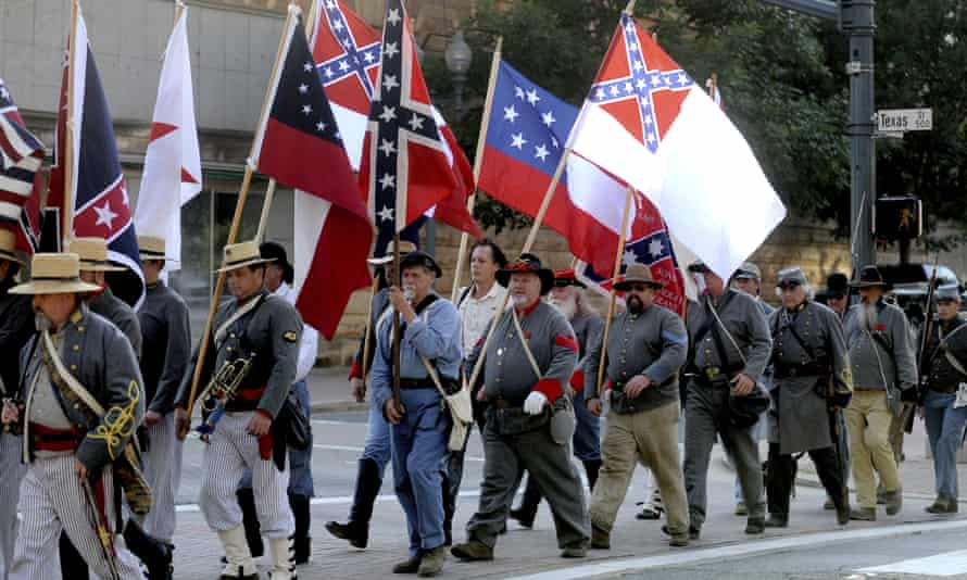 Sons of Confederate Veterans and others march through downtown Shreveport, Louisiana, on their way to commemorate Confederate Memorial Day in 2011.