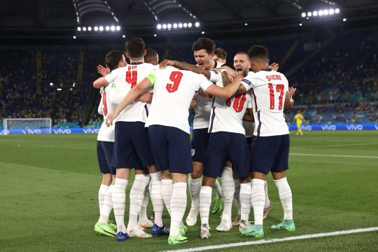 Harry Kane of England celebrates with Harry Maguire, Luke Shaw and team mates after scoring their side's third goal during the UEFA Euro 2020 Championship Quarter-final match between Ukraine and England