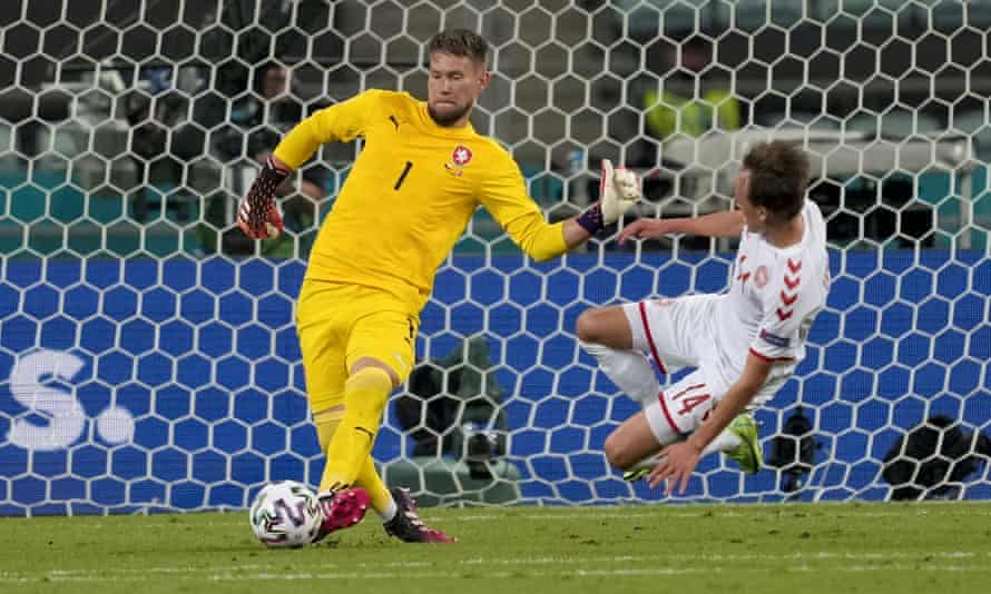 Czech Republic's goalkeeper Tomas Vaclik clears the ball away from challenge from Denmark's Mikkel Damsgaard.