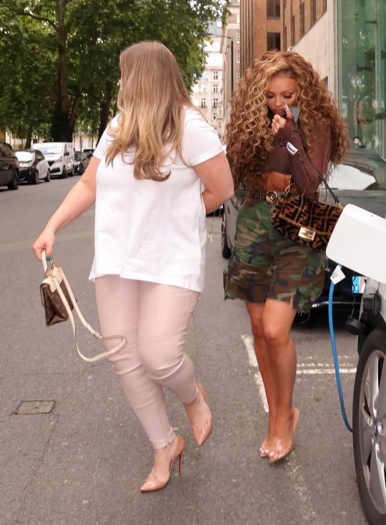 Jesy Nelson walking with her friend