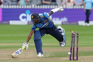 Chamika Karunaratne just makes his ground as a throw from Chris Woakes breaks the stumps.