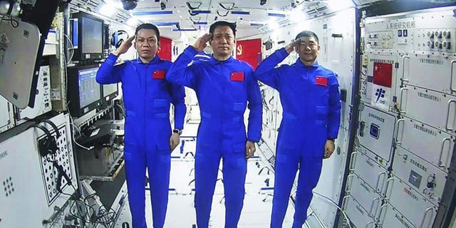 The astronauts arrived June 17 for a three-month mission aboard China's third orbital station, part of an ambitious space program that landed a robot rover on Mars in May. (AP)