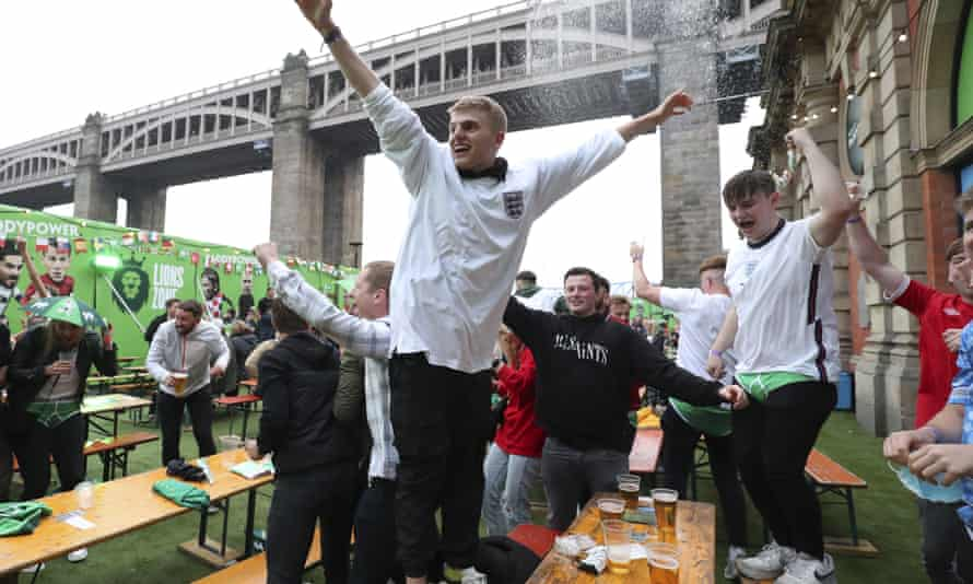 England supporters celebrate after Harry Maguire scored the second goal against Ukraine