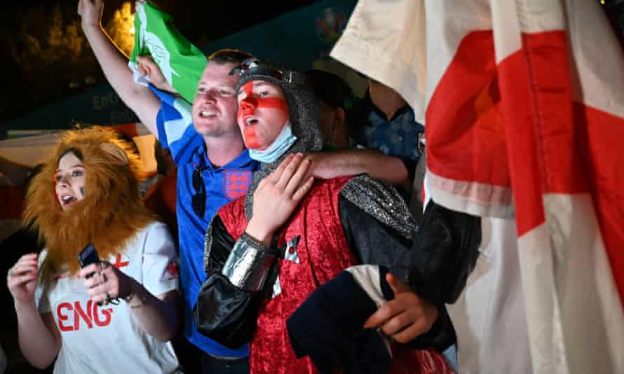 England's fans celebrate their team's victory in front of the Olympic Stadium in Rome