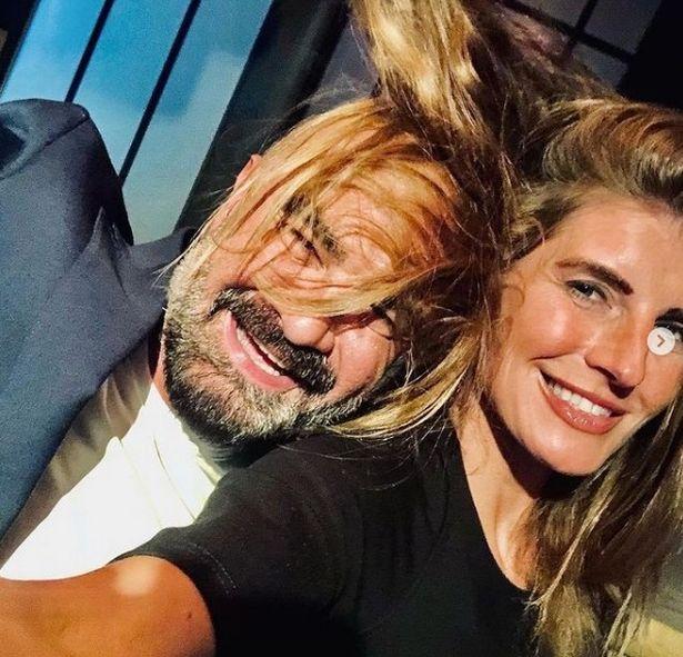 Windswept: Amanda shares shot with hairdresser Andrew Barton.