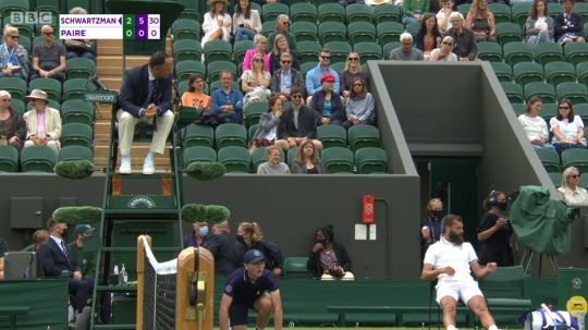 Benoit Paire argues his case with umpire Mohamed Lahyani during his Wimbledon exit.