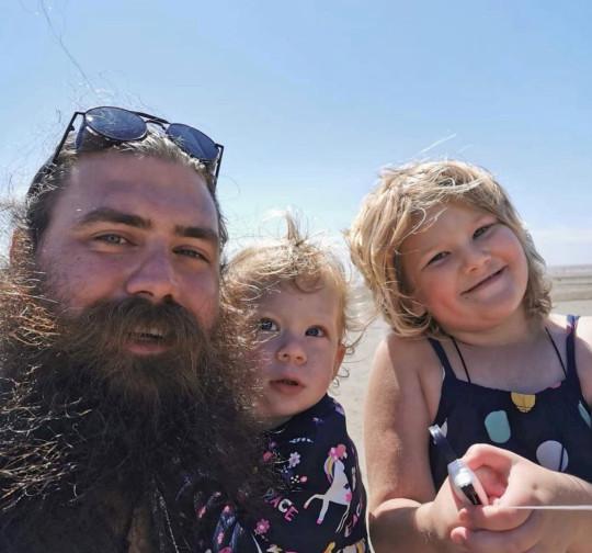 Aaron Sankey with his daughters Kayla and Daya