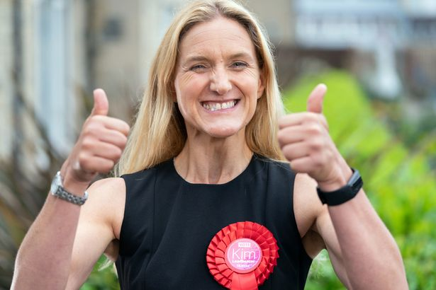 Kim Leadbeater celebrates by a canal in Huddersfield after winning the Batley and Spen by-election
