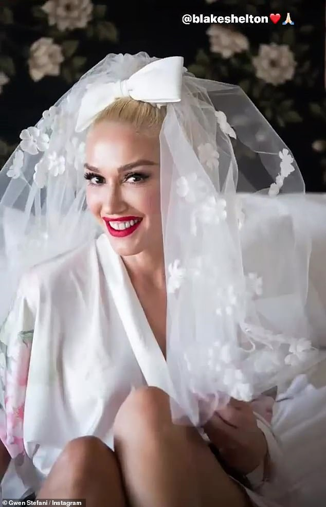 Going to the chapel!The pop singer posted a playful video of herself throwing her veil over her head while getting glammed up for her special day