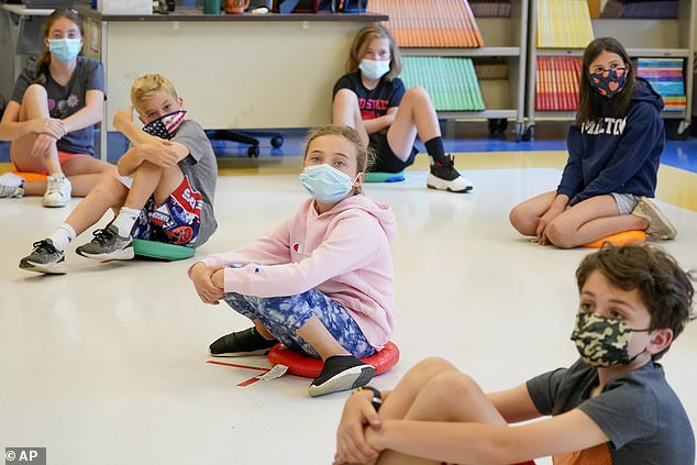 Children were largely required to wear face masks in schools that reopened last year, though there is little evidence young kids spread COVID-19 at schools