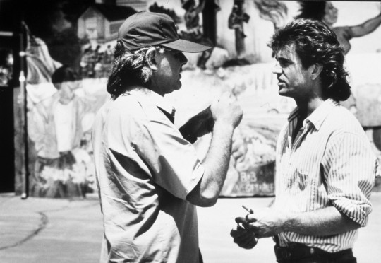 FILM STILL OF 'LETHAL WEAPON' WITH 1987, RICHARD DONNER, MEL GIBSON, MULLET, DIRECTOR DIRECTS, BEHIND THE SCENES IN 1987 VARIOUS