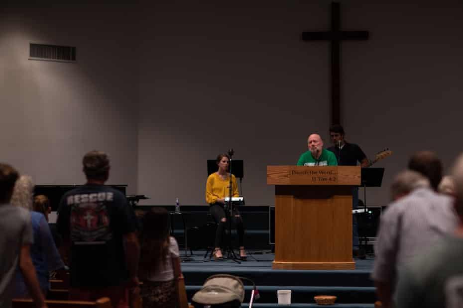 Rusty Thomas rallies attendees at Desert Hills Bible church on 24 June.