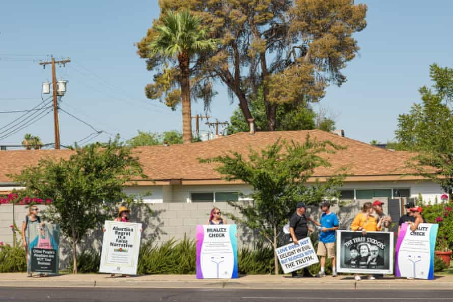 Pro-choice activists talk with members of Operation Save America in Phoenix.