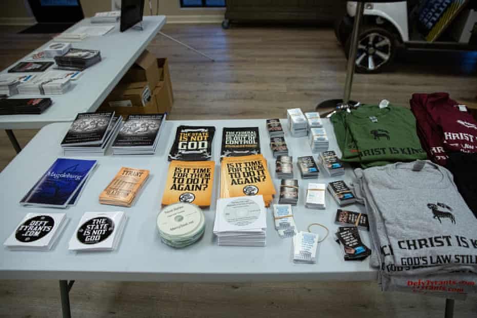 Far-right groups display literature and shirts for sale at the Operation Save America Conference at Desert Hills Bible church in Phoenix.