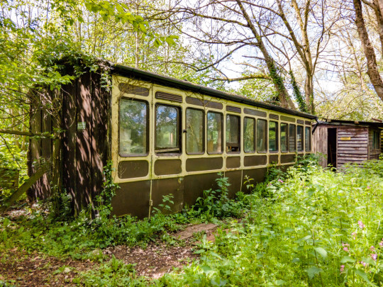 train carriage in the garden of converted railway station