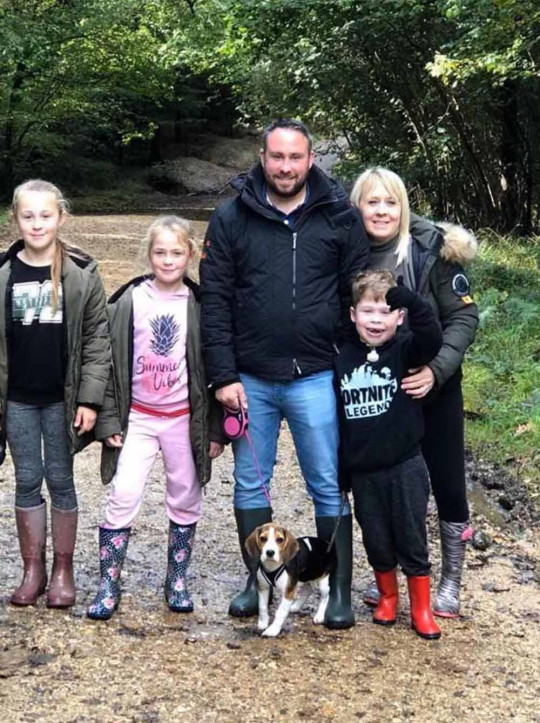 Mikey with his mum Chevonne, dad George, sisters Mika and Skye and the family dog, Peppa. PA REAL LIFE/COLLECT