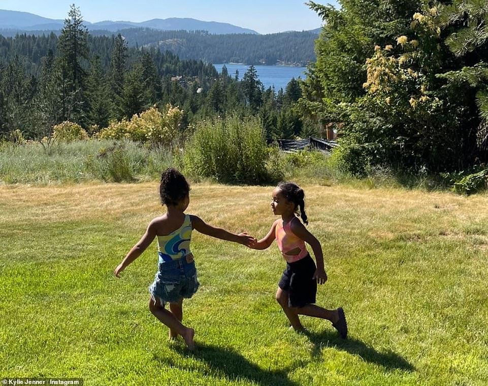 Beautiful afternoon:Additionally, the makeup mogul uploaded snaps of her daughter twirling around a grassy field with one of her cousins as they marked Fourth Of July together