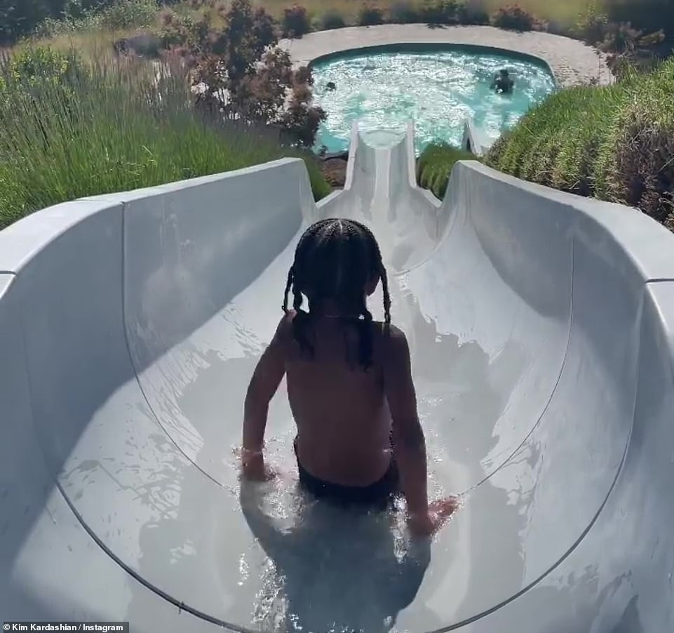 Massive slide: LittleChicago looked as cute as ever as she slid down the water slide in a pink swimsuit
