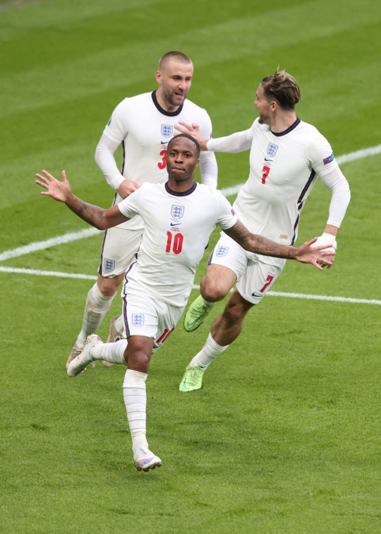 Raheem Sterling of England celebrates the opening goal with Jack Grealish and Luke Shaw during the UEFA Euro 2020 Championship Round of 16 match between England and Germany at Wembley Stadium on June 29, 2021 in London, United Kingdom. (Photo by Marc Atkins/Getty Images)