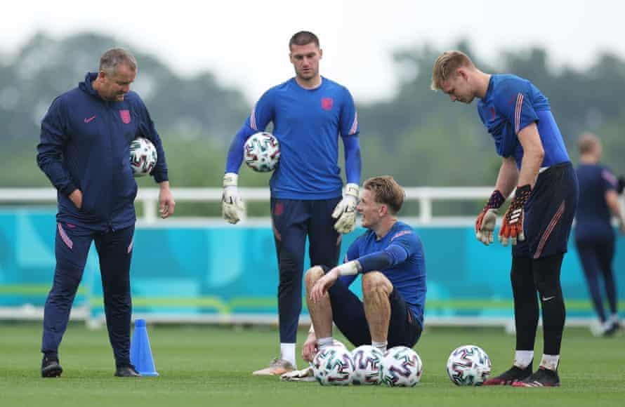 Sam Johnstone, Jordan Pickford and Aaron Ramsdale of England speaking to Martyn Margetson, England goalkeeper coach.
