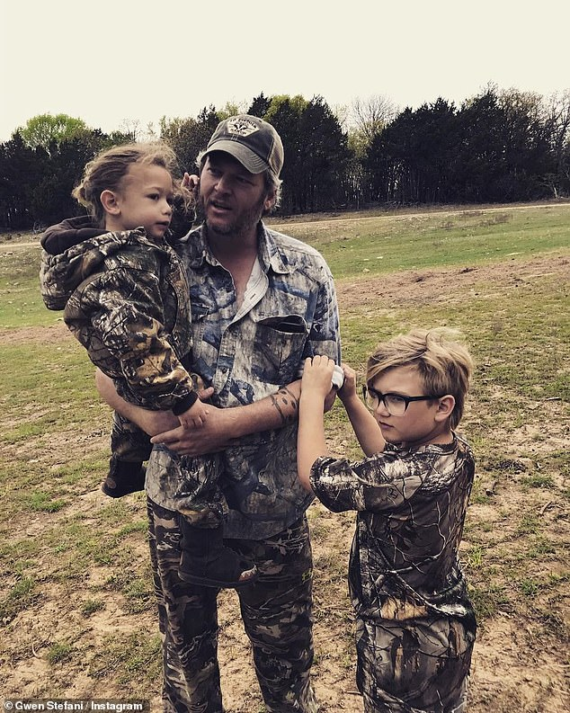 Camo in the country: The hitmaker with Gwen's two youngest suns as they enjoy the outdoors