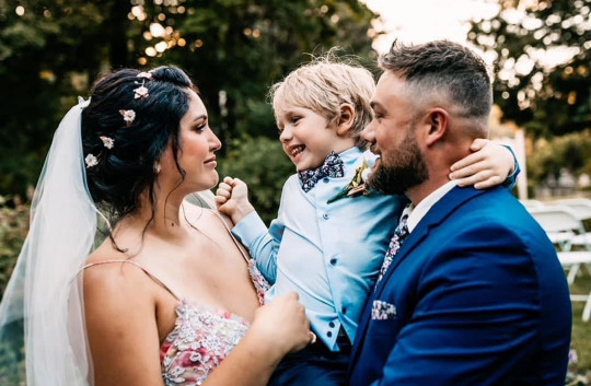 @Ofwilddawnphoto / CATERS NEWS (PICTURED Elizabeth, Kyle and son Sawyer on their wedding day) A mum who broke her spine during labour has miraculously walked down the aisle after surgery saved her life. Elizabeth Smith suffered a serious fracture to her tailbone and two herniated discs in her spine during the traumatic birth of her first child, Sawyer. The 32-year-old, from Ontario in Canada, had a happy and healthy pregnancy but during labour, a series of medical complications meant that she was left in unbearable pain and unable to move without help. Her back pain were so severe it left her suicidal as she pleaded with doctors for 18 months to give her spinal surgery ??? which she says has now saved her life. SEE CATERS COPY