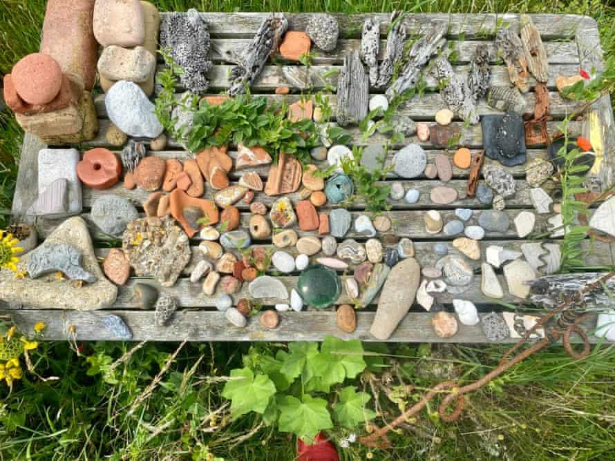 A table of foreshore treasures (stones, pebbles etc) at Shingle Street. Suffolk-Essex coast, UK.