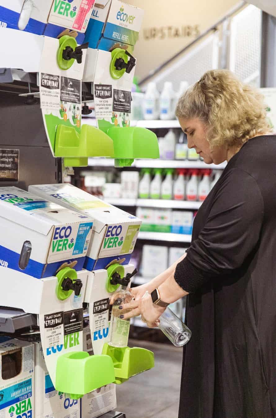 Emily Byron refilling Ecover bottles