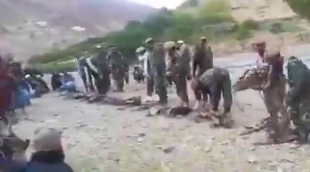 The Taliban uploaded footage which purports to show Afghan National Army troops laying down their US-made arms and surrendering