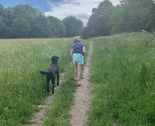nancy walking with shani through a field