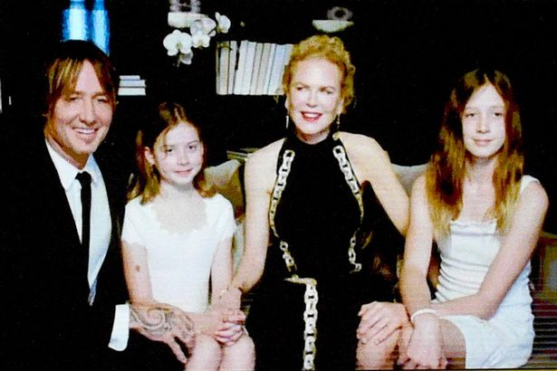 Nicole and her husband with their daughters