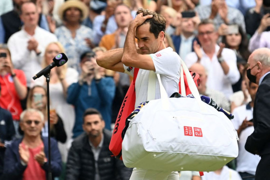 Switzerland's Roger Federer leaves the court after losing to Poland's Hubert Hurkacz during their men's quarter-finals match on the ninth day of the 2021 Wimbledon Championships at The All England Tennis Club in Wimbledon, southwest London, on July 7, 2021.