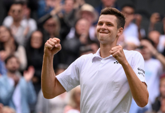 Hubert Hurkacz of Poland celebrates winning his men's Singles Quarter Final match against Roger Federer of Switzerland on Day Nine of The Championships - Wimbledon 2021 at All England Lawn Tennis and Croquet Club on July 07, 2021 in London, England.
