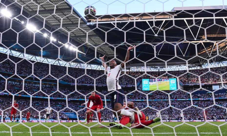 Denmark captain Simon Kjær inadvertently steers an equaliser for England into his own net under pressure from Raheem Sterling.
