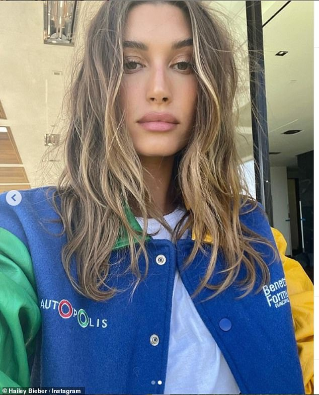 Fresh locks:Justin Bieber's wife wore her tousled highlighted hair in a middle parting and also took to Instagram to show her 35.8million followers her lightened locks