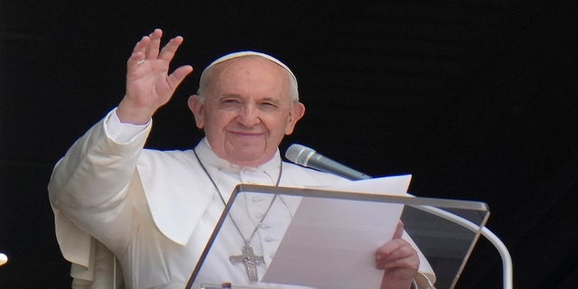 Pope Francis waves to the crowd as he arrives to recite the Angelus noon prayer from the window of his studio overlooking St. Peter's Square, at the Vatican, on July 4. (AP)