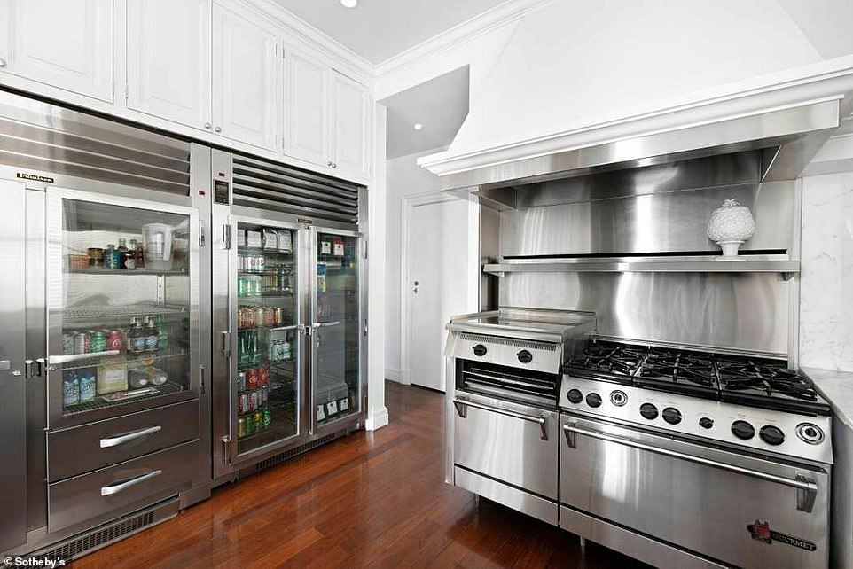 Let's eat: An eat-in chef's kitchen boasts an impressive line of appliances including a Wolf industrial range and double Traulsen refrigerators