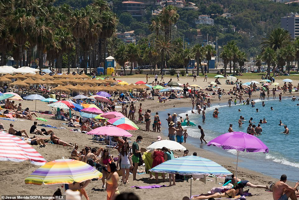 Quarantine-free holidays are set to be unlocked for millions of families to more than 130 countries ¿ including the US, Thailand and Spain (pictured, Malaga)