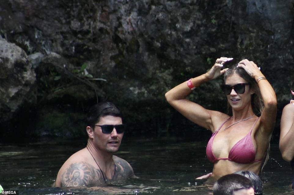 Hot pink:During the swimming trip Haack slipped her fit figure into a pink swimsuit which put her flat abs and long legs in the spotlight