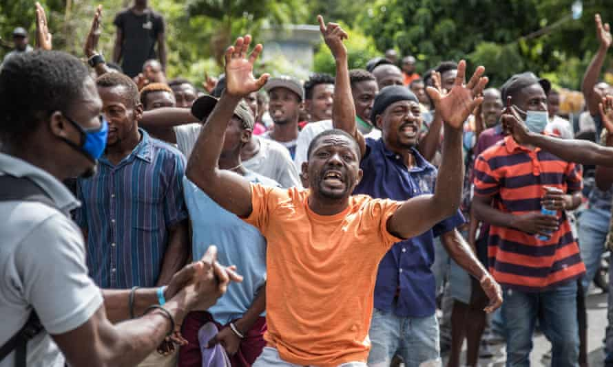 The crowd near the police station where the armed men accused of involvement in the assassination of president Jovenel Moise were detained in Port au Prince, Haiti.