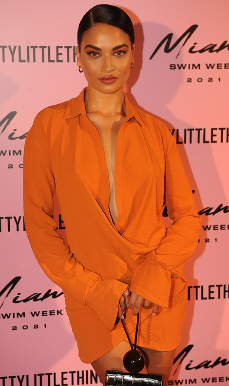 Wow! Model Shanina Shaik commanded attention in a tiny orange mini dress