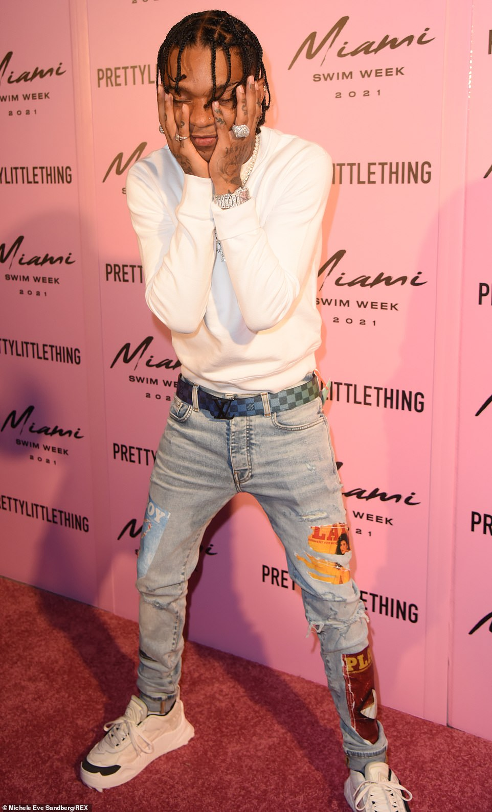 Headliner: Swae Lee, 28, was tapped as one of a few performers for the event and he was seen jumping around on a water covered runway