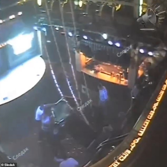 Footage shows shocked witnesses gathering at the scene and removing the metal construction from the victim