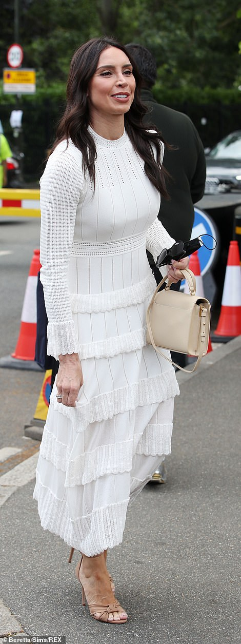 A vision in white: Christine Lampard looked sensational as she sported a tiered white dress that skimmed over her lithe figure