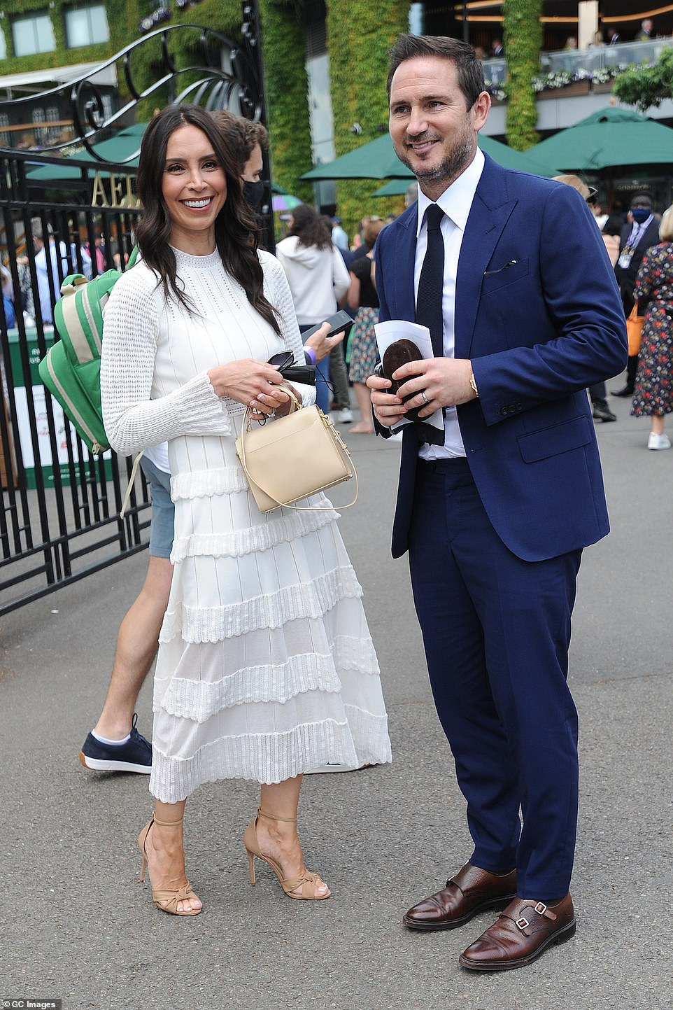 Fashionista: Christine teamed her white dress with nude heels and a leather bag to match