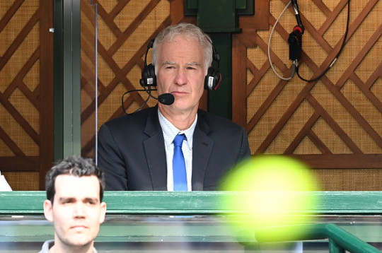 John McEnroe commentates from the Wimbledon Championships at All England Lawn Tennis and Croquet Club on July 01, 2021 in London, England.