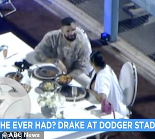 Impressive: The table was set up close to the dugout near the third-base side of the field and a tuxedo clad bartender stood a little ways off behind a white bar that was erected for the night