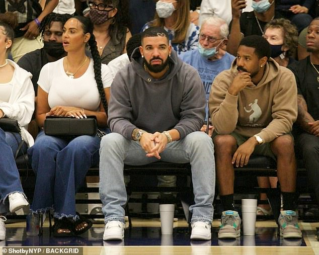 Supportive fans:The God's Plan singer was seated courtside next to actor and friend Michael B. Jordan with the model/actress cheering on her son to his right