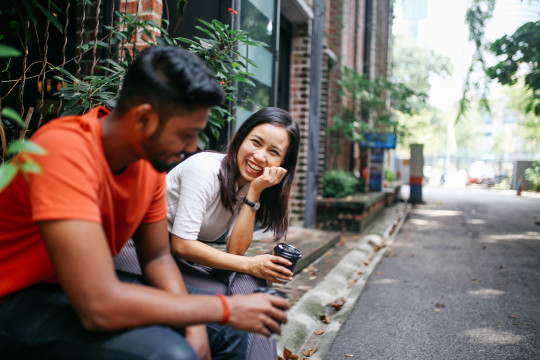 Friends chatting outdoors in Kuala Lumpur, Malaysia