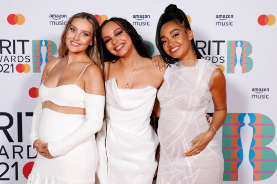 Perrie Edwards, Jade Thirlwall and Leigh-Anne Pinnock of Little Mix pose in the media room during The BRIT Awards 2021 at The O2 Arena on May 11, 2021 in London, England